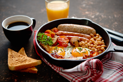 Full English breakfast on dark rusty background