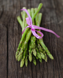 Bunch of fresh green asparagus spears tied with ribbon